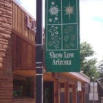 Show Low sign: A City of Four Seasons (image)